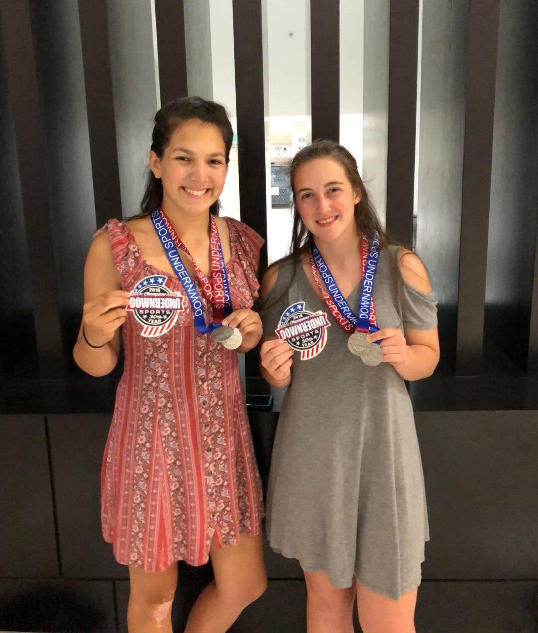 Vienne Sereseroz and Sam Bennett pose with their golf medals in Australia