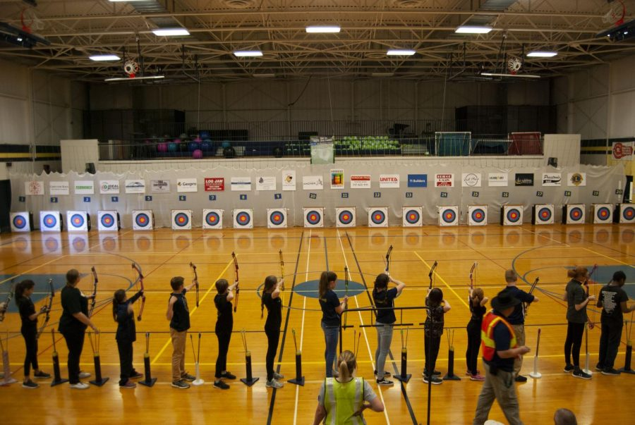Archers+shoot+from+the+15+meter+line+at+the+Grand+Ledge+Archery+Classic.+Volunteers+helped+with+setting+up+the+targets%2C+sponsor+signs%2C+target+numbers%2C+and+even+put+the+shooters+tape+down+on+the+floor.%0A