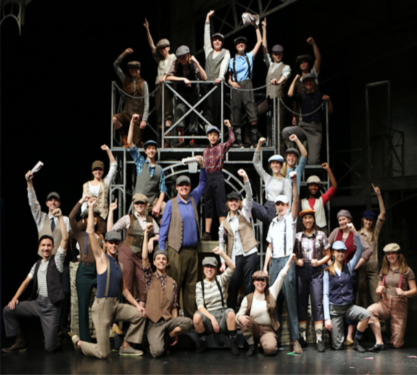 The+Newsies+cast+recreates+the+photo+from+the+original+article+written+for+the+article%2C+%22Newsies+Stop+The+World%2C%22+in+The+Sun+publication.+The+original+article+was+written+in+1899.
