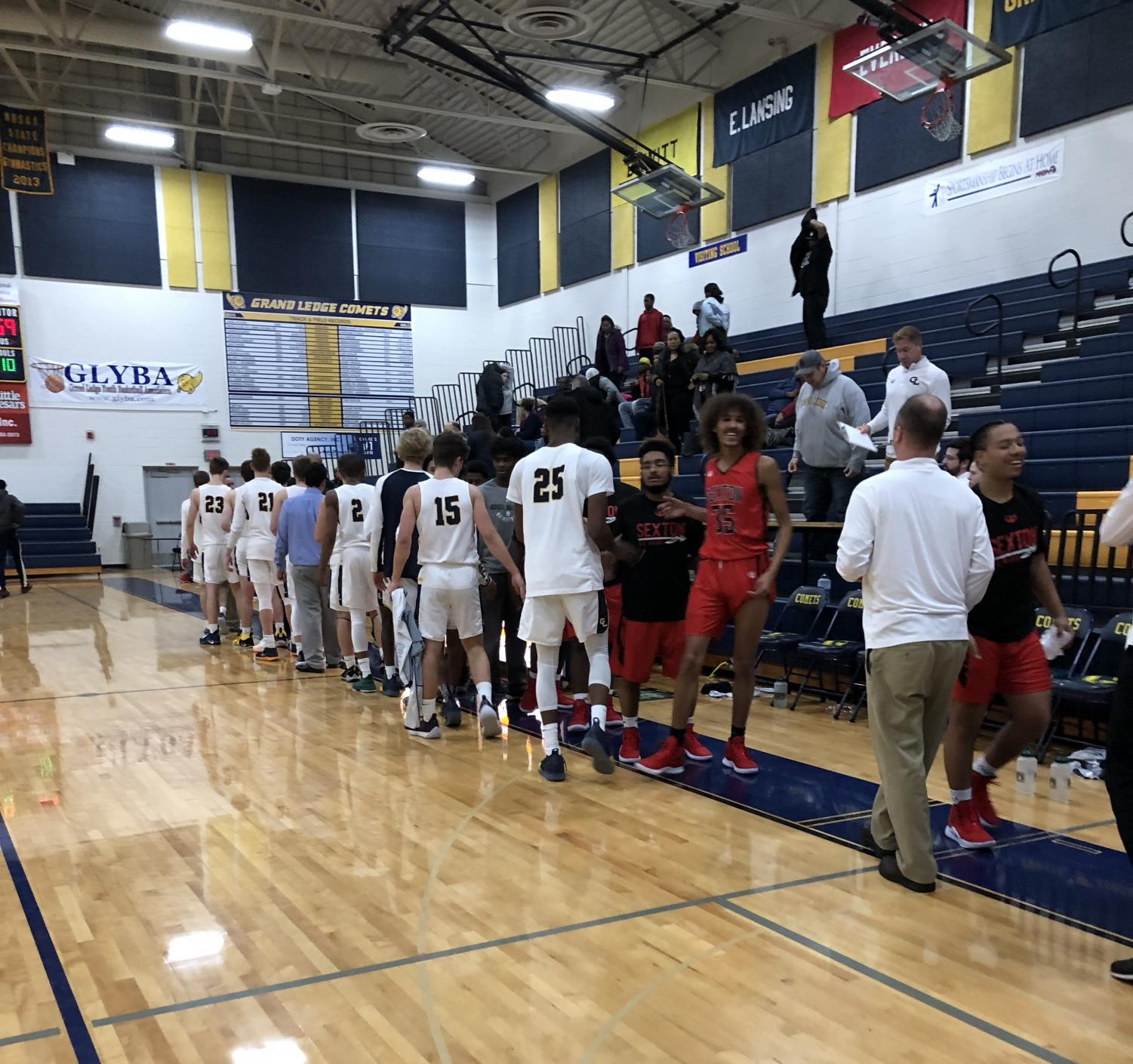 Grand Ledge shakes hands with the Sexton Big Reds after a 76-59 victory on December 11. The Comets are hoping to ride this wave of momentum heading into the bulk of conference play.