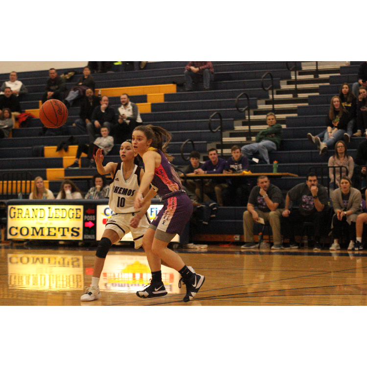 Todd+keeps+her+eyes+on+the+ball+while+playing+defense+against+Okemos.+During+the+season+she+averaged+20.7+point+per+game+this+year.
