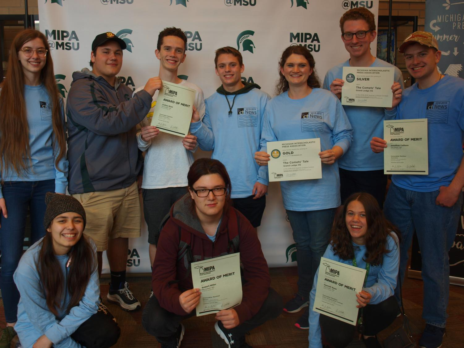 The Comets' Tale staff poses with their Honorable Mention certificates and Silver and Gold Medal certificates for the newspaper and website. The Comets' Tale attended the event on April 23 at the Lansing Center.