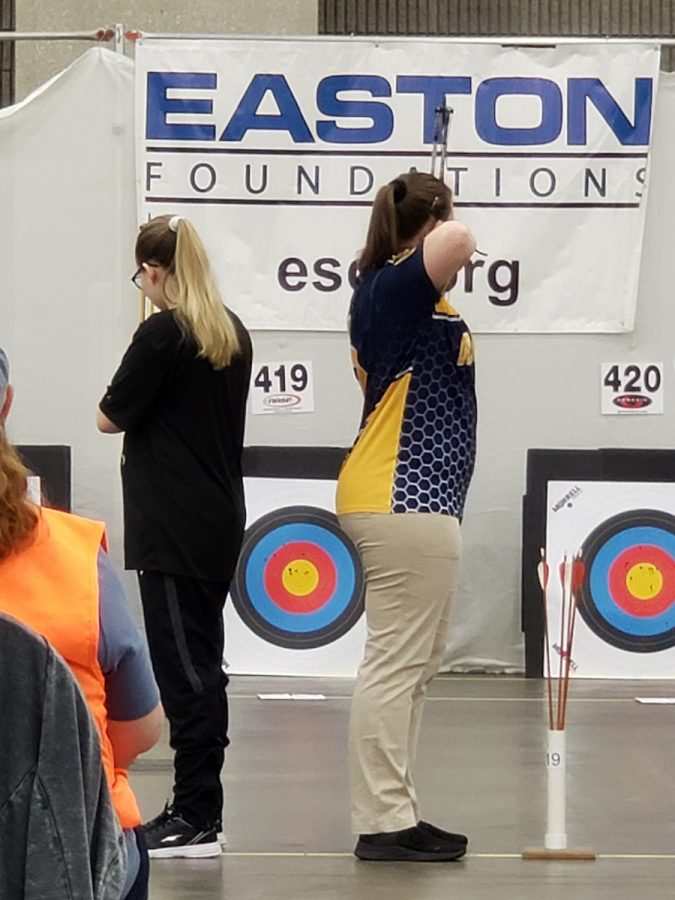 Jordyn+Yockey+%2811%29+aiming+for+the+center+ring+of+the+target+at+the+Nationals+Tournament.+Yockey+shot+the+highest+score+for+the+high+school+team+and+placed+48th+out+of+7%2C109+girls.