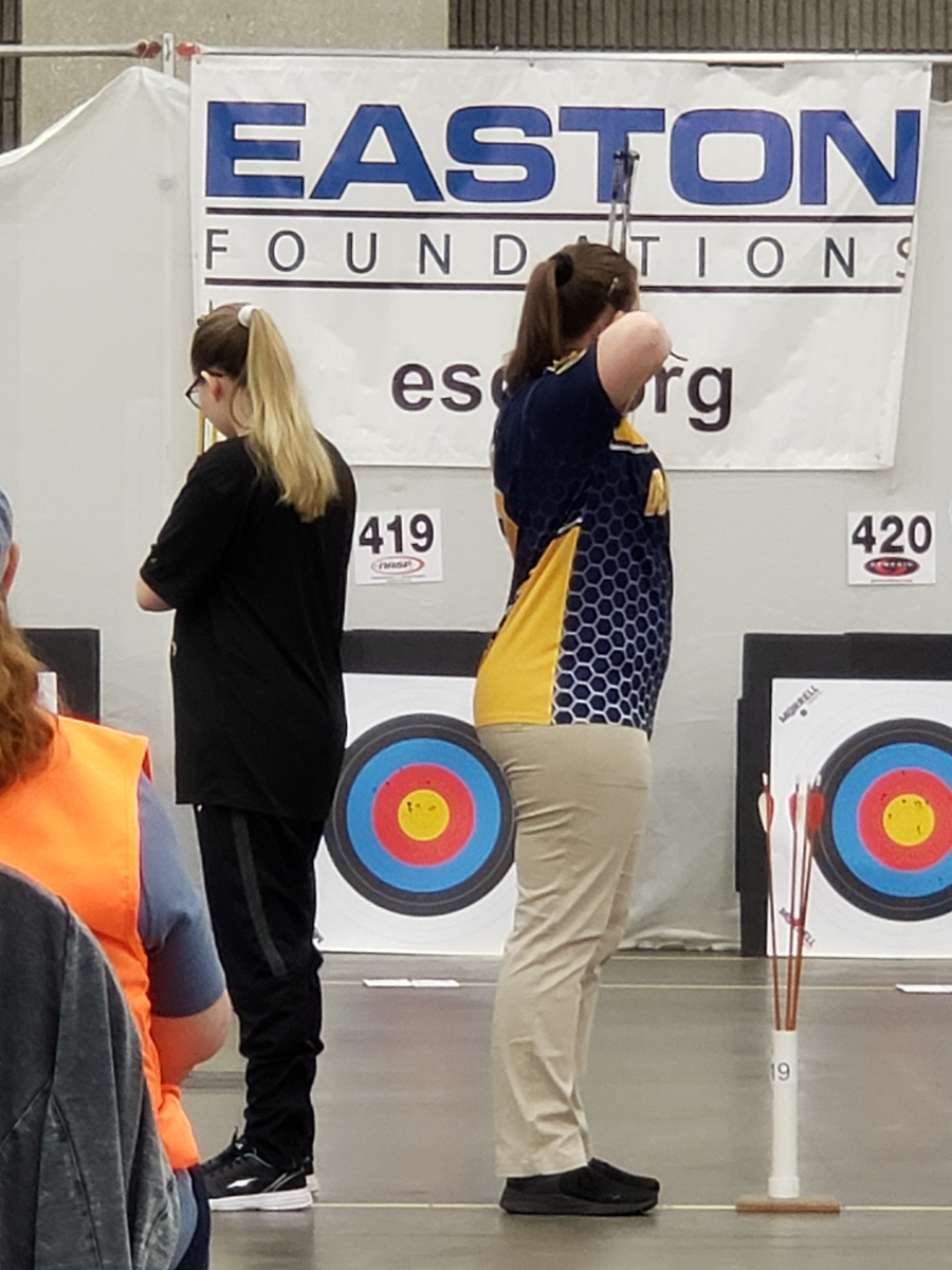 Jordyn Yockey (11) aiming for the center ring of the target at the Nationals Tournament. Yockey shot the highest score for the high school team and placed 48th out of 7,109 girls.