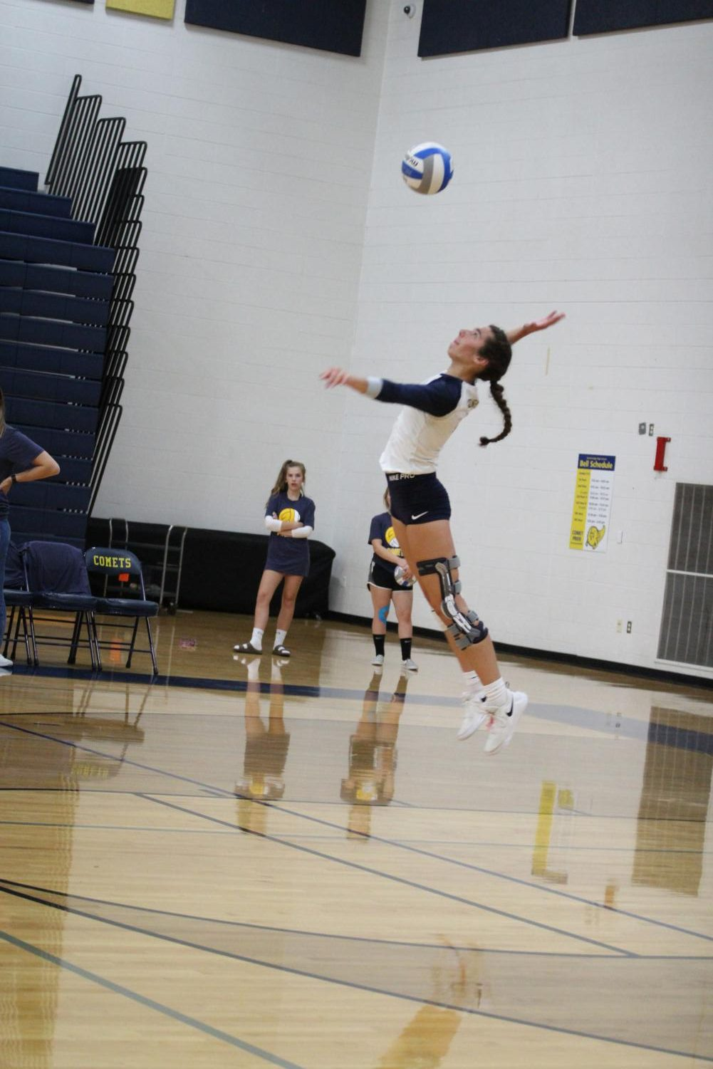 Senior Peyton Goschka serving during her most recent match. The team won against Waverly, the opposing team.