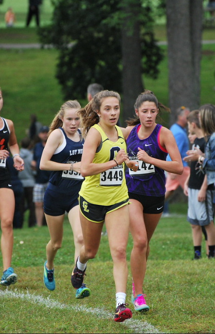 Ella Baryo, a junior on the girls' cross country team, races past the competition as she looks toward the finish. She ran at Kensington Metropark on Sept. 7.