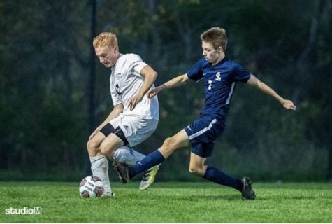 Camden Schuchaskie (right) tries to steal the ball from a defending player. Schuchaskie has recently won the LSJ Athlete of the Week award as member of the Grand Ledge Varsity Soccer team.