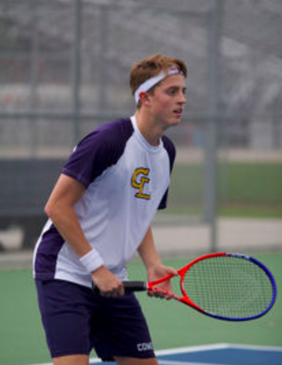 Tyler McCready stands ready as his opponent serves. This was McCready's first year on the tennis team.