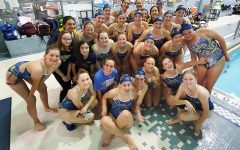 Varsity Girls swim team poses together at their meet in Okemos on September 19. GL swam away with a win!