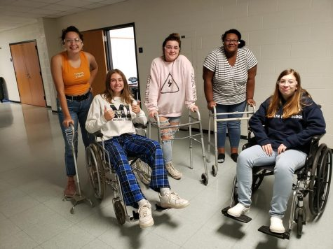 Students in the training program try out simulated disabilities. Impaired vision, and trouble walking are common  disabilities among the elderly.