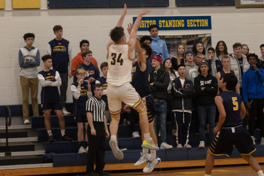 The Ledge played a fantastic game against Haslett. Devan Wilson is pictured taking a great jump shot.
