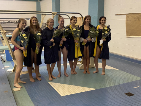The Senior Girls line up for pictures after walking with their families. Each one received flowers and a gift in honor of the four long years they have spent on the pool deck.