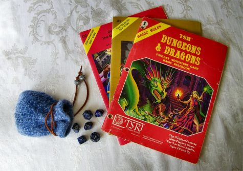"""""""Original Dungeons and Dragons Basic Rule Book - 1981 - Plus 2 Dugeon Modules"""" by Jennie Ivins is licensed under CC BY-NC-SA 2.0"""